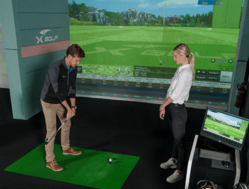 X-Golf Coach Giving Player a Golf Lesson