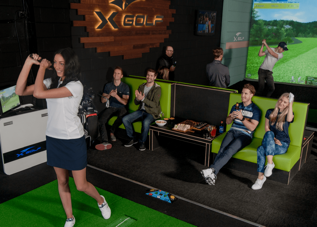 Group of Golfers Playing X-Golf