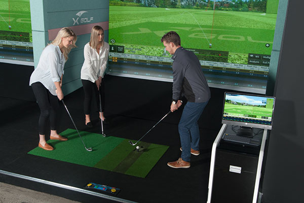 X-Golf Professional Giving Lessons to Female Players
