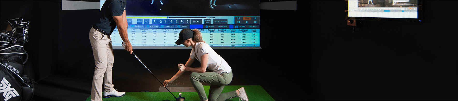 X-Golf Lessons - Coach helping Player Improve