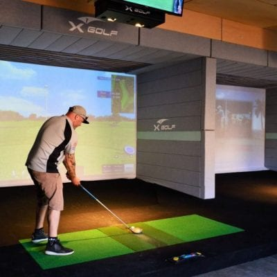 X-Golf Parkwood - Player Practicing Golf Indoors