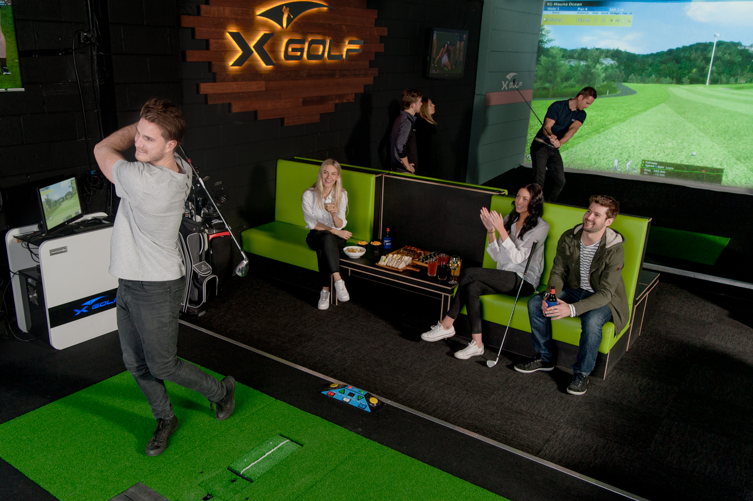 Group of Players enjoying X-Golf Indoor Golf