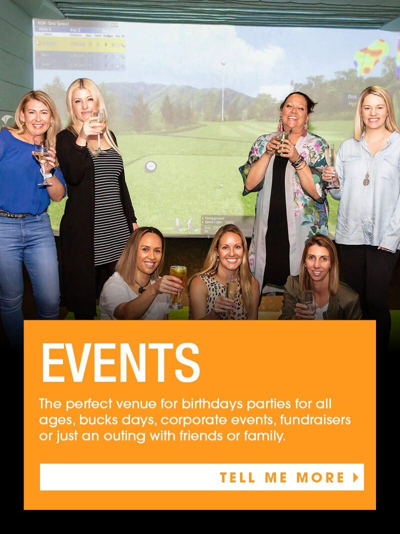 Ladies drink wine infront of X-golf simulator