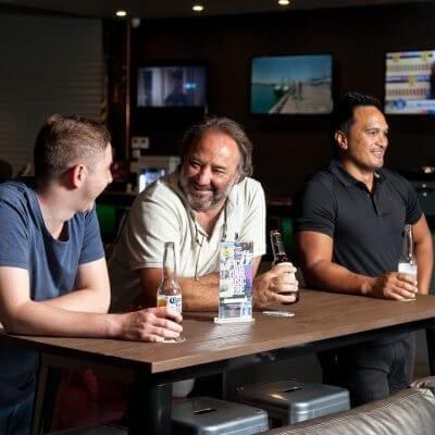 3 men drinking beer