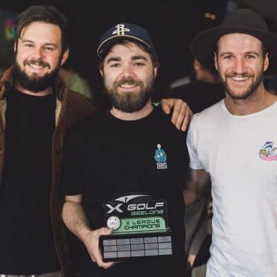 X-league golf competition men holding trophy